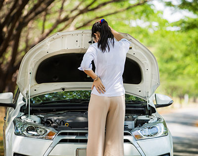 Woman with Car Engine Problems